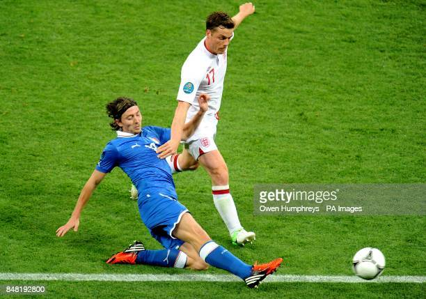 Italy's Riccardo Montolivo and England's Scott Parker battle for the ball