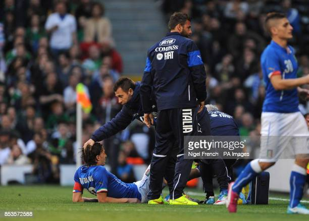 Italy's Riccardo Montolivo lies injured during the game against the Republic of Ireland during the International Friendly at Craven Cottage London