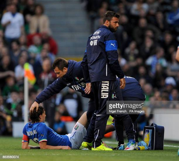 Italy's Riccardo Montolivo lies injured on the pitch