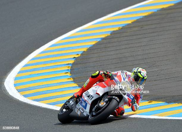 Italy's rider Andrea Iannone competes on his Ducatti N29 and clocked the third position during the qualifying cession of the MotoGP ahead of the...