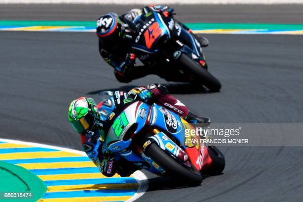 Italy's rider Franco Morbidelli competes on his Kalex Estrella Galicia 00 Marc VDS N°21 followed by Italy's rider Francesco Bagnaia on his Sky Racing...