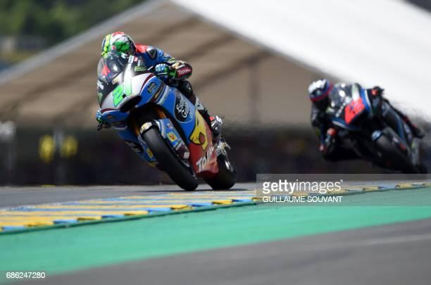 Italy's rider Franco Morbidelli on his Kalex Estrella Galicia 00 Marc VDS N21 competes ahead of Italy's rider Francesco Bagnaia on his Sky Racing...