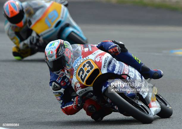 Italy's rider Niccolo Antonelli competes on his Honda OngettaRivacold N��23 ahead Argentina's rider Gabriel Rodrigo on his KTM RBA Racing Team N��19...