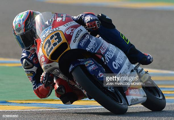 Italy's rider Niccolo Antonelli competes on his Honda OngettaRivacold N 23 and clocked the pole during the Moto3 qualifying cession of the French...