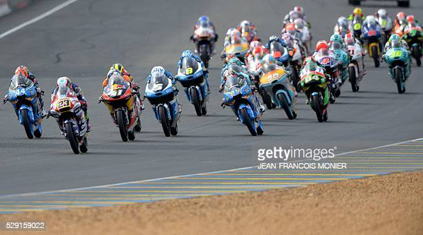 Italy's rider Niccolo Antonelli on his Honda OngettaRivacold N��23 leads ahead South Africa rider Brad Binder on his Red Bull KTM Ajo N��41 Italy's...
