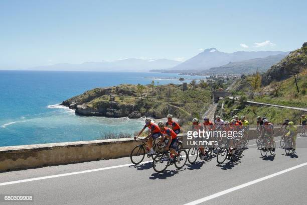 Italy's rider of team Bahrain Merida Vincenzo Nibali and Giovanni Visconti train with teammates along the sea on the first rest day of the 100th Giro...