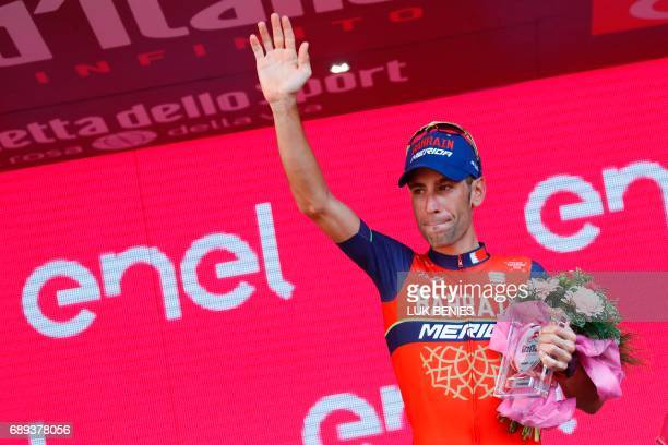 Italy's rider of team Bahrain Merida Vincenzo Nibali celebrates his third place on the podium of the 100th Giro d'Italia Tour of Italy cycling race...