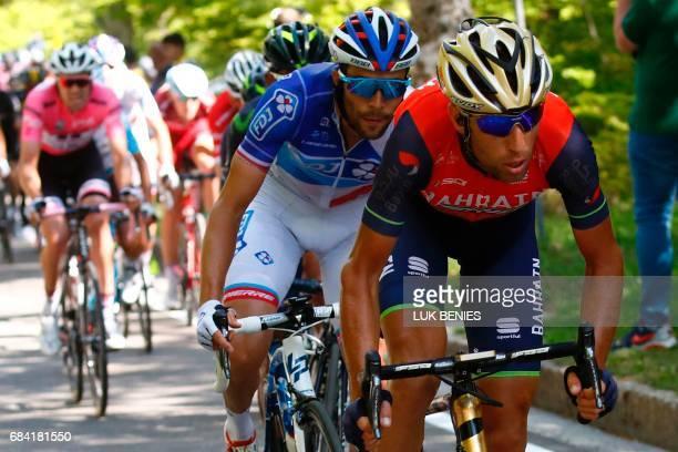Italy's rider of team Bahrain Merida Vincenzo Nibali rides ahead France's Thibaut Pinot of team FDJ and Colombia's Nairo Quintana of team Movistar...