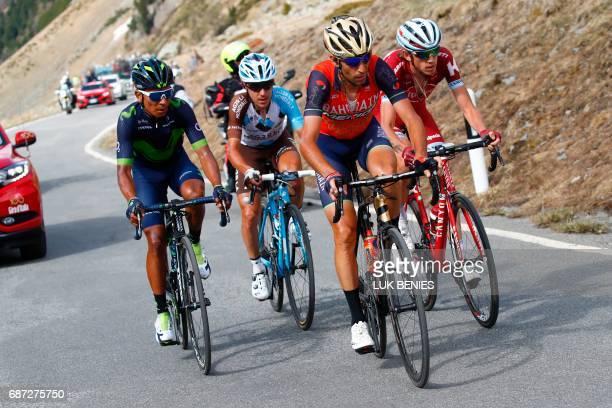 Italy's rider of team Bahrain Merida Vincenzo Nibali rides ahead Colombia's Nairo Quintana of team Movistar Russia's Ilnur Zakarin of team Katusha...