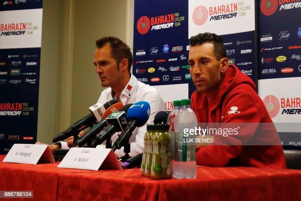 Italy's rider of team Bahrain Merida Vincenzo Nibali speaks next to Sport director Gorazd Stangelj during a press conference on May 22 2017 in...
