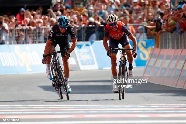 TOPSHOT Italy's rider of team Bahrain Merida Vincenzo Nibali sprints to cross the finish line ahead Spain's Mikel Landa of team Sky during the 16th...