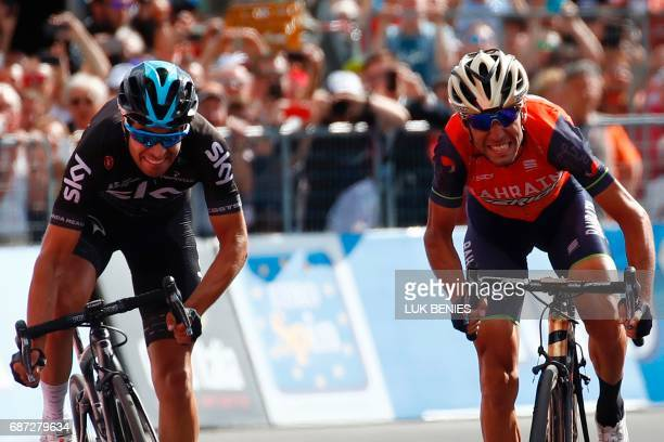 Italy's rider of team Bahrain Merida Vincenzo Nibali sprints to cross the finish line ahead Spain's Mikel Landa of team Sky during the 16th stage of...