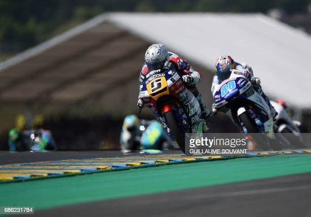 Italy's rider Romano Fenati on his Marinelli Rivacold Snipers N5 competes ahead of Spain's rider Jorge Martin on his Del Conca Gresini Moto3 N88...