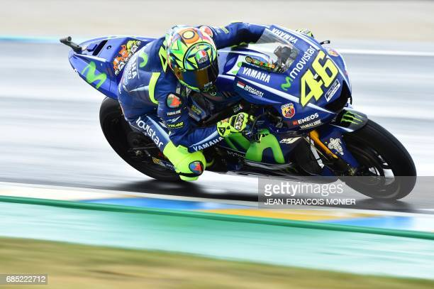 TOPSHOT Italy's rider Valentino Rossi competes on his Movistar Yamaha MOTOGP N°46 during a MotoGP free practice session ahead of the French...