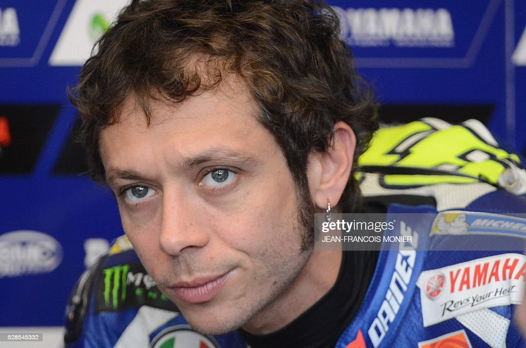 Italy's rider Valentino Rossi (Movistar Yamaha MOTOGP N��46) looks on in his pit during a motoGP free practice session, ahead of the French motorcycling Grand Prix, on May 6, 2016 in Le Mans, northwestern France. / AFP / JEAN