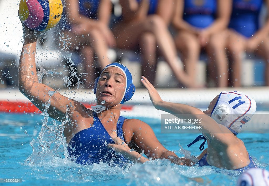 Italy's Roberta Bianconi fights for the ball with Russia's Evgeniya Ivanova during the Water Polo European Championships match in Budapest on July 18...