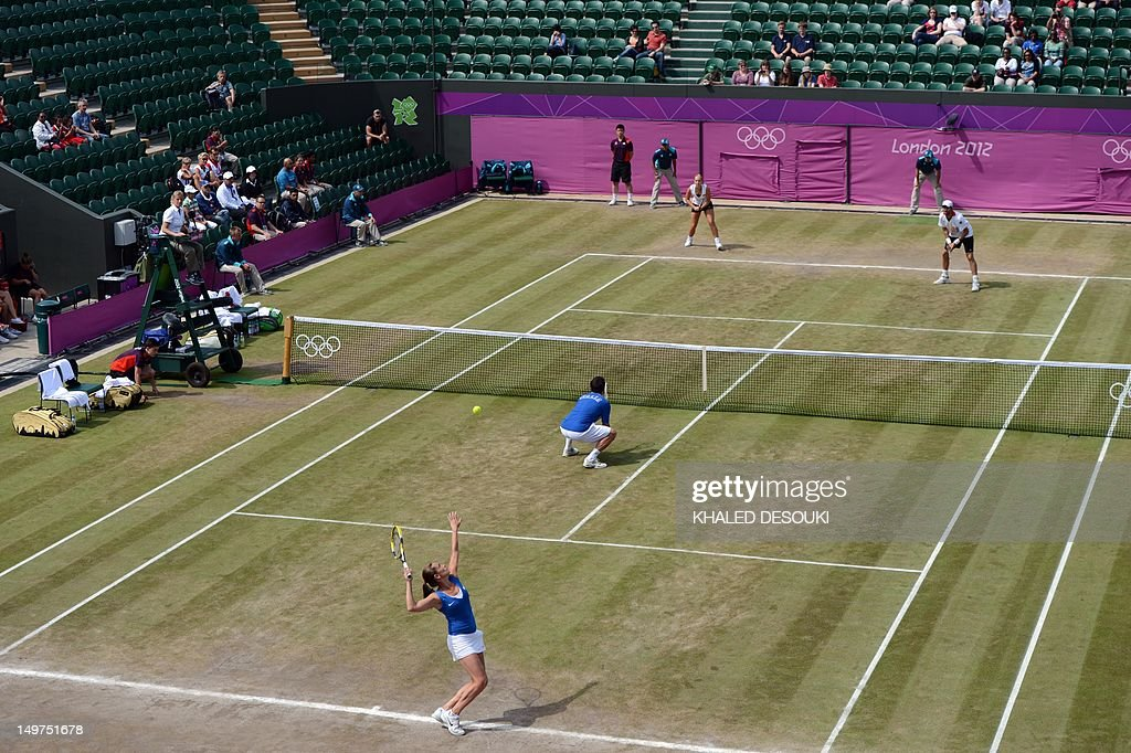Italy's Roberta Vinci and Daniele Bracciali returns to Germany's Sabine Lisicki and Christopher Kas during their London 2012 Olympic Games mixed double quarter final match at the All England Tennis Club in Wimbledon, southwest London, on August 3, 2012.