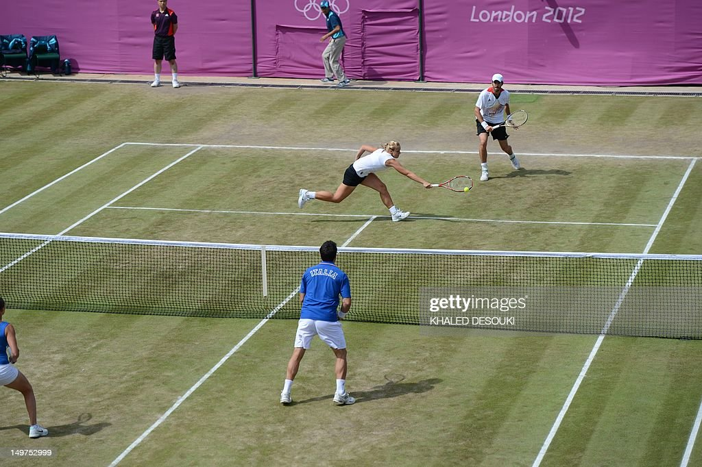 Italy's Roberta Vinci and Daniele Bracciali returns to Germany's Sabine Lisicki and Christopher Kas (foreground) during their London 2012 Olympic Games mixed double quarter final match at the All England Tennis Club in Wimbledon, southwest London, on August 3, 2012. AFP PHOTO / KHALED DESOUKI
