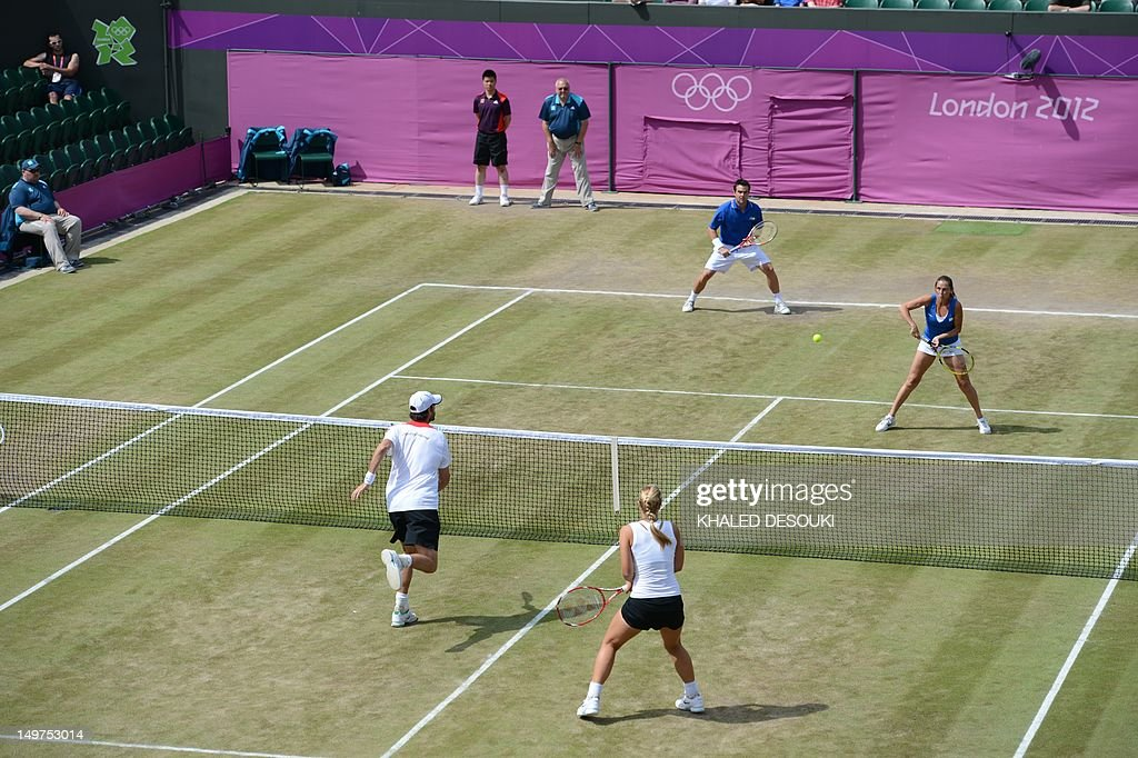 Italy's Roberta Vinci and Daniele Bracciali returns to Germany's Sabine Lisicki and Christopher Kas (foreground) during their London 2012 Olympic Games mixed double quarter final match at the All England Tennis Club in Wimbledon, southwest London, on August 3, 2012.