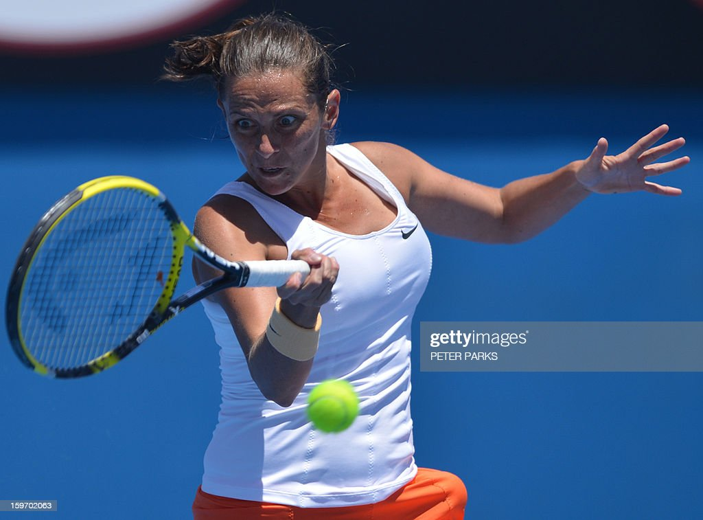 Italy's Roberta Vinci hits a return against Russia's Elena Vesnina during their women's singles match on day six of the Australian Open tennis tournament in Melbourne on January 19, 2013.