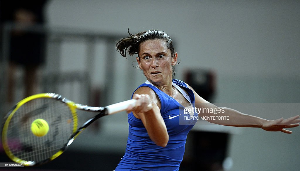 Italy's Roberta Vinci returns a ball to US player Jamie Hapton during their Fed Cup tennis match in Rimini's 105 Stadium on February 10, 2013.Vinci won 6-2, 4-6, 6-1 as Italy is drawing noe 2 all.