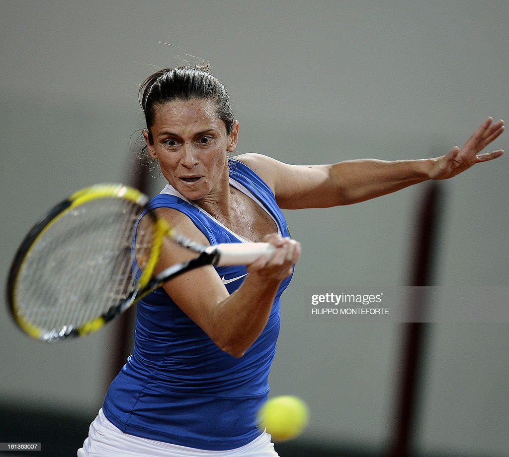 Italy's Roberta Vinci returns to US player Jamie Hapton during their Fed Cup tennis match in Rimini's 105 Stadium on February 10, 2013.Vinci won 6-2, 4-6, 6-1 as Italy is drawing noe 2 all. AFP PHOTO / FILIPPO MONTEFORTE