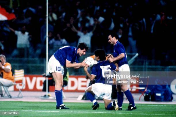 Italy's Roberto Baggio is congratulated by teammates Dino Baggio and Salvatore Schillaci after scoring a superb individual goal