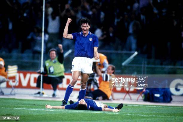 Italy's Roberto Baggio lies flat out after scoring a superb individual goal as teammate Paolo Maldini congratulates him