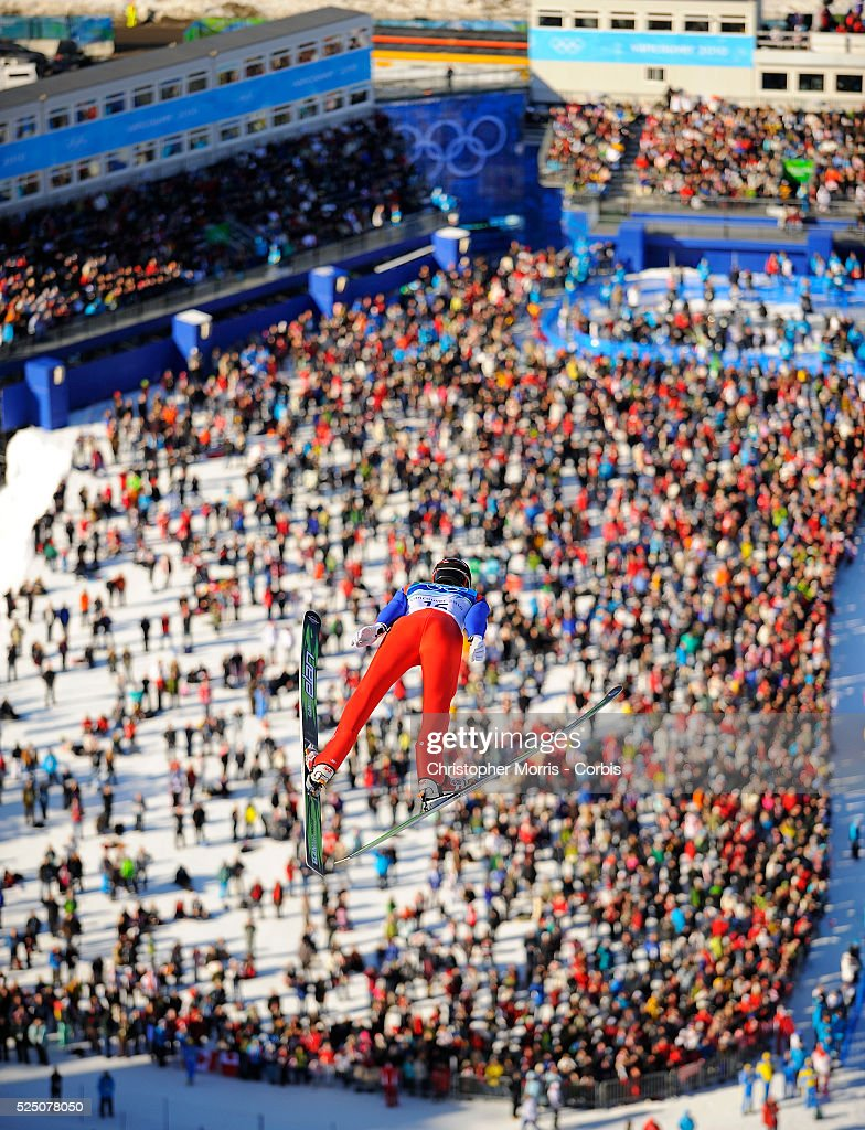 Italy's Roberto Dellasega above the crowd during the qualification round for the long hill individual ski jumping at Whistler Olympic Park on day 8...
