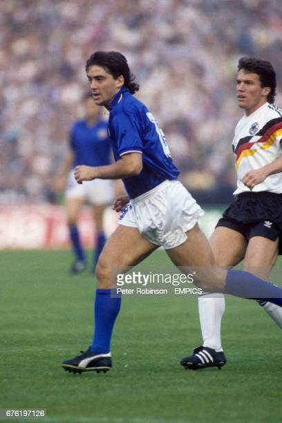 Italy's Roberto Mancini in action with West Germany's Lothar Matthaus