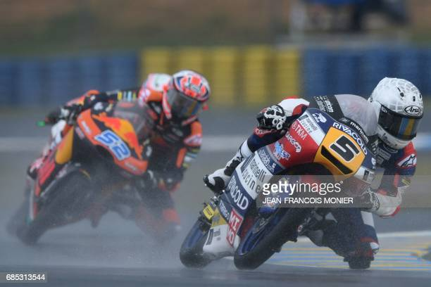 Italy's Romano Fenati competes on his Marinelli Rivacold Snipers N°5 ahead England's rider Danny Kent on his Red Bulll KTM AJO N°52 during a moto3...
