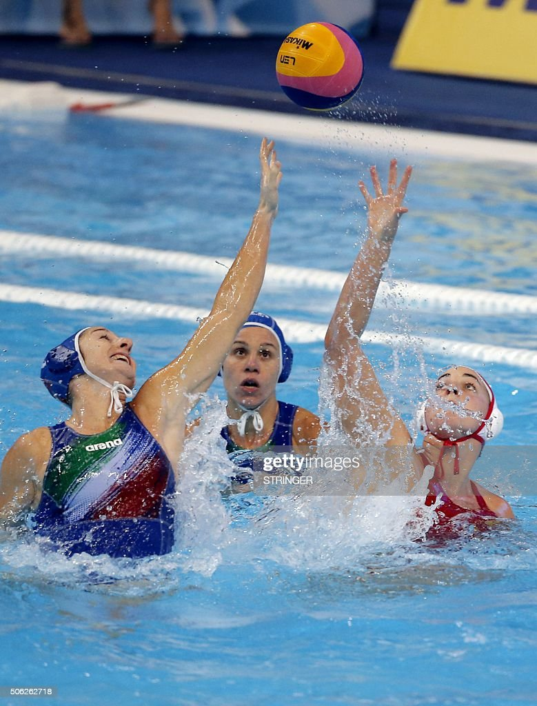 Italy's Rosaria Aiello and Tania Di Mario vies for the ball with Spain's Jennifer Pareja during the women's water polo bronze medal match between...