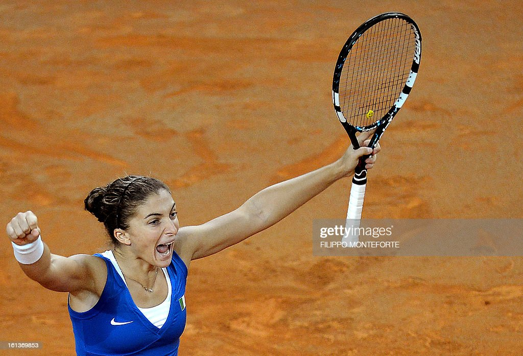 Italy's Sara Errani celebrates after winning with teammate Roberta Vinci against US players Varvara Lepchenko and Liezel Huber during their Fed Cup tennis match in Rimini's 105 Stadium on February 10, 2013. They won 6-2, 6-2 as Italy beats USA 3-2 going throught the semifinals.