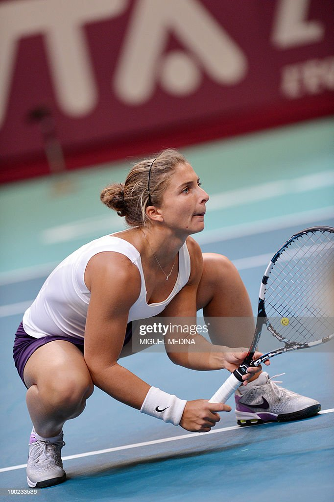 Italy's Sara Errani concentrates during her match against France's pair at the 21st Paris Open, part of the WTA tournament, on January 28, 2013 at the Pierre de Coubertin stadium in Paris. AFP PHOTO / MIGUEL MEDINA