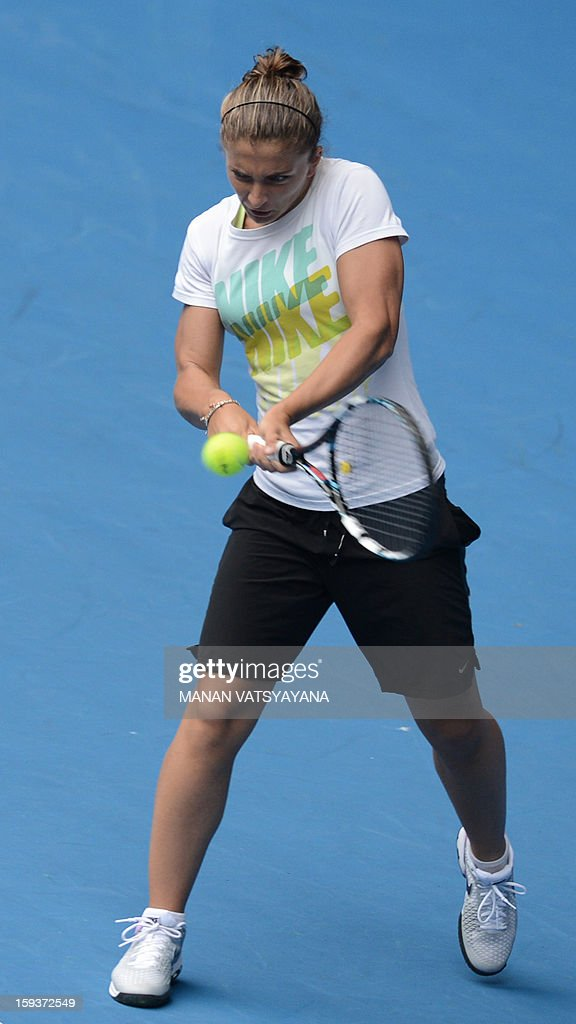 Italy's Sara Errani plays a return during a practice session ahead of the 2013 Australian Open tennis tournament in Melbourne on January 13, 2013.