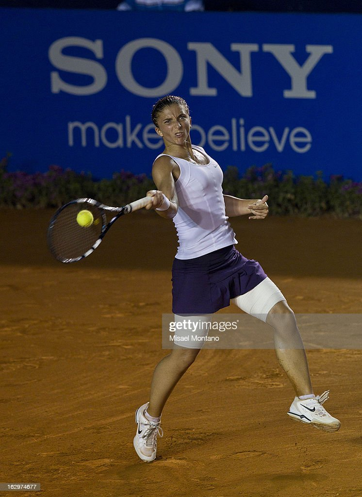 Italy´s <a gi-track='captionPersonalityLinkClicked' href=/galleries/search?phrase=Sara+Errani&family=editorial&specificpeople=599213 ng-click='$event.stopPropagation()'>Sara Errani</a> returns the ball to Franceá Alice Cornet during the Acapulco Tennis Open in the Pacific resort in Acapulco, Monday, March 1, 2013