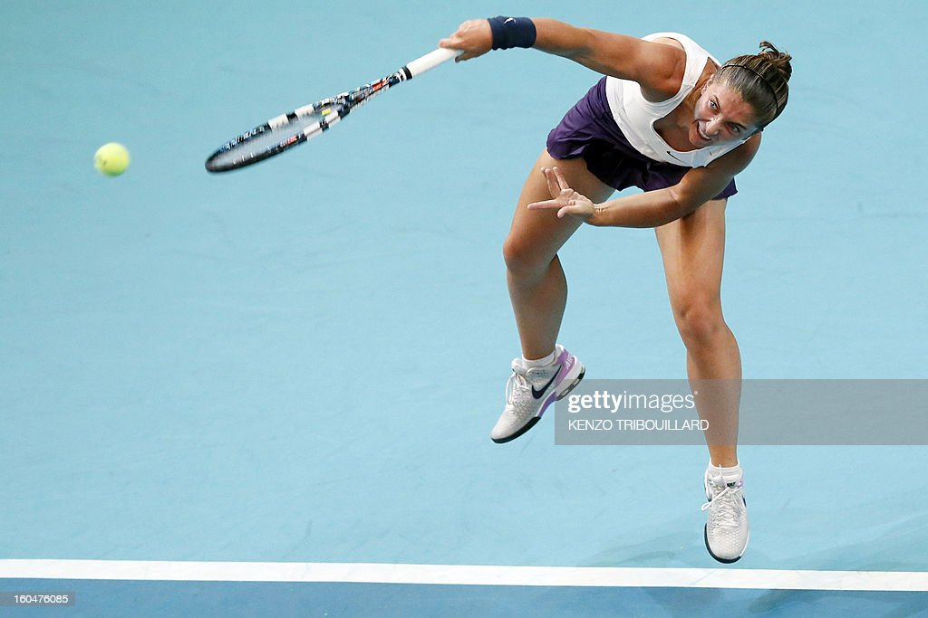 Italy's Sara Errani serves to opponent Spain's Carla Suarez Navarro during the 21st edition of the Paris WTA Open on February 1, 2013.