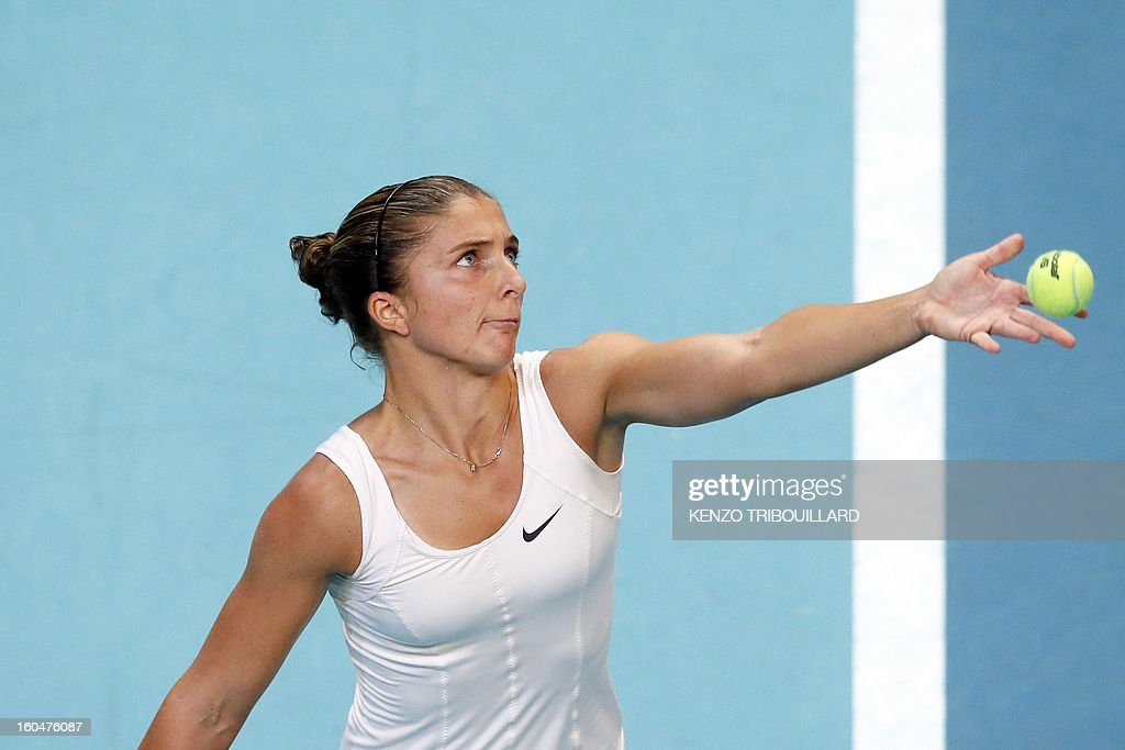 Italy's Sara Errani serves to opponent Spain's Carla Suarez Navarro during the 21st edition of the Paris WTA Open on February 1, 2013.