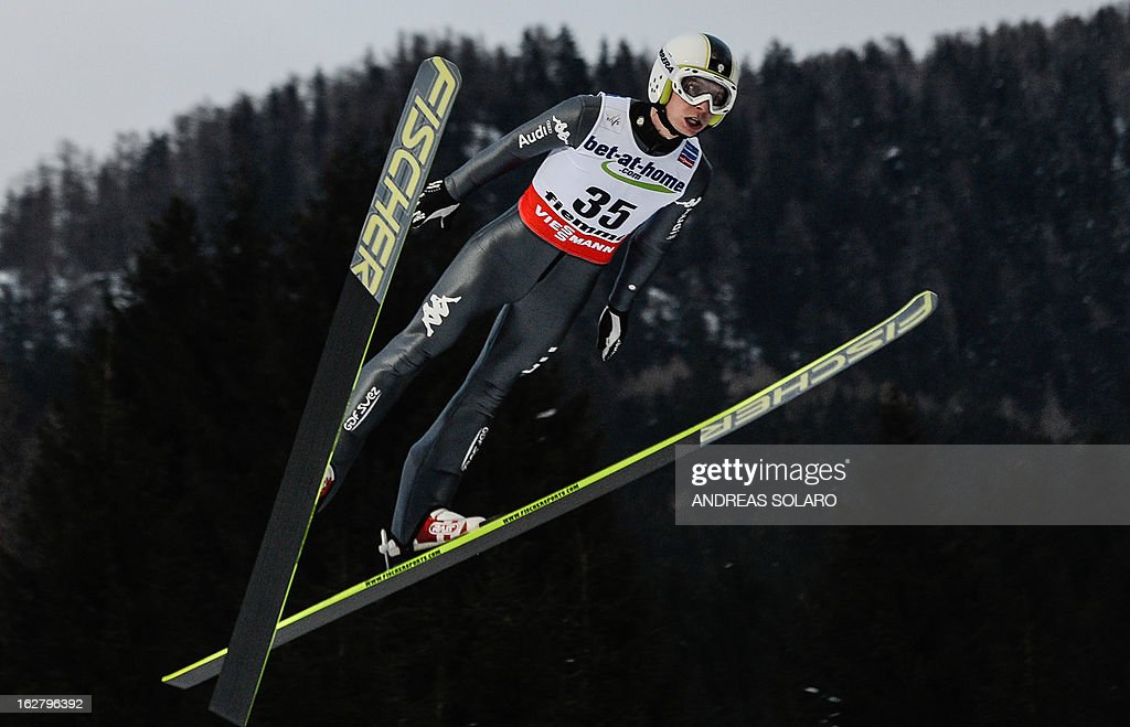 Italy's Sebastian Colloredo soars through the air on February 27, 2013 during the Large Hill Individual qualification race of the FIS Nordic World Ski Championships at the Ski Jumping stadium in Predazzo, northern Italy.