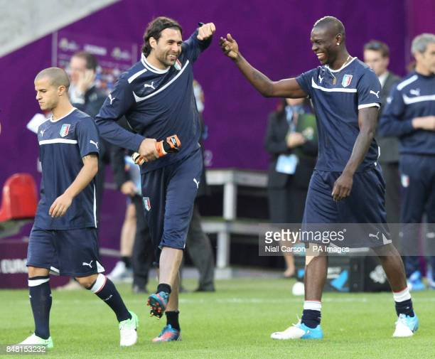 Italy's Sebastian Giovinco walks by as Mario Balotelli shares a joke with goalkeeper Salvatore Sirigu during a Training Session at the Municipal...