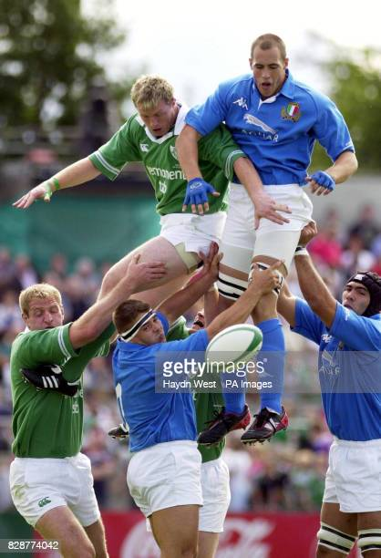 Italy's Sergio Parisse beats Ireland's Eric Miller in the lineout during their international friendly match at Thomond Park Limerick
