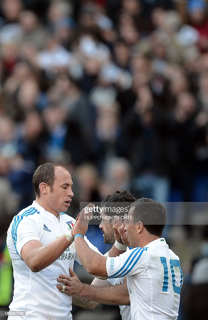 Italy's Sergio Parisse celebrates with teamates after scoring during the Six Nations international rugby union match between Italy and France in Rome's Olimpic Stadium on February 3, 2013.