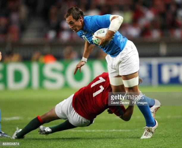 Italy's Sergio Parisse is tackled by Antonio Aguilar of Portugal during the Rugby World Cup Group C match at the Parc des Princes Paris France
