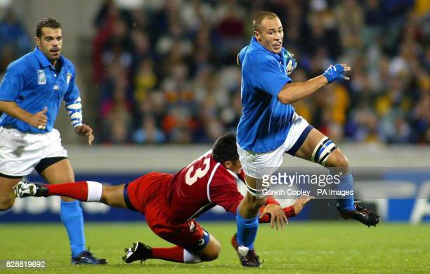 Italy's Sergio Parisse is tackled by Tonga's Gus Leger during their Rugby World Cup pool match at Bruce Stadium Canberra Australia NO MOBILE PHONE...