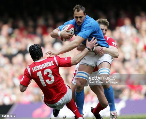 Italy's Sergio Parisse is tackled by Wales' Halo Luscombe and Matthew Watkins during the RBS 6 Nations match at the Millennium Stadium Cardiff...