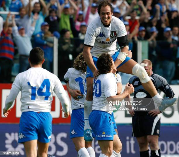 Italy's Sergio Parisse jumps on Pietro Travagli in celebration after beating Scotland during the RBS 6 Nations match at the Stadio Flaminio Rome Italy
