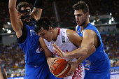 Italy's shooting guard Marco Belinelli and Italy's power forward Danilo Gallinari defend against Croatia's forward Dario Saric during the final match...