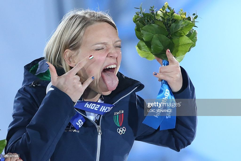 Italy's silver medalist Arianna Fontana poses during the Women's Short Track 500 m Medal Ceremony at the Sochi medals plaza during the Sochi Winter Olympics on February 13, 2014.
