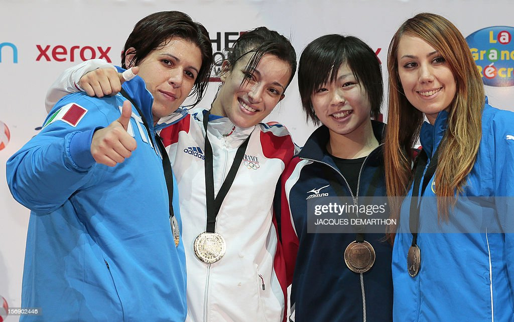 Italy's silver medalist Greta Vitelli, France's gold medalist Nadege Ait-Ibrahim, Japan's bronze medalist Ayumi Uekusa and Greece's bronze medalist Eleni Chatziliadou pose on the podium of the Female Kumite over 68kg category at the Karate world championships on November 24, 2012 in Paris.