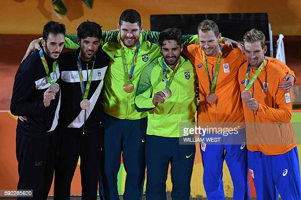 Italy's silver medallists Paolo Nicolai and Daniele Lupo Brazil's gold medallists Alison Cerutti and Bruno Oscar Schmidt and Netherlands' bronze...